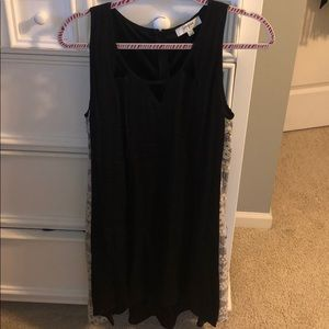 Black dress with white lace detailing on side